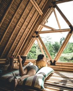 Girl laying in the Hideout Bali bamboo house A Frame Cabin, A Frame House, Bamboo House Design, Bamboo Building, Treehouse Hotel, Bamboo Structure, Bamboo Architecture, Tiny House Cabin, H & M Home