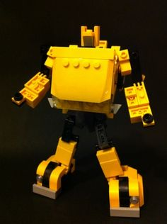 This is a Lego Generation 1 Transformer Bumblebee - Volkswagen with mini figure scale and it is fully transformable into robot type. Lego Transformers, Transformers Bumblebee, Lego Robot, Lego Toys, Alex Wong, Awesome Lego, Cool Lego Creations, Lego Models, Lego Stuff