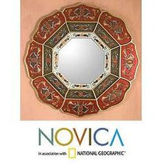 @Overstock - Edmundo Contreras crafts a mirror that reflects the rich artistry of Peru's Colonial era. Shaped like a flowery octagon, the mirror's red, green and white panels feature hand-painted blossoming medallions edged in gilt.http://www.overstock.com/Worldstock-Fair-Trade/Glass-Octagon-Flower-Mirror-Peru/6369960/product.html?CID=214117 $297.99