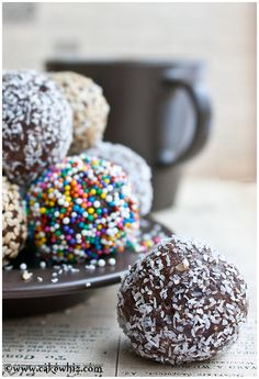 FUDGY CHOCOLATE DATE BALLS covered in sprinkles, toasted sesame seeds and shredded coconut. These bite-sized energy balls are healthy, vegan and gluten free.From cakewhiz.com