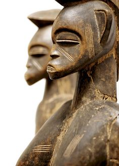 A rare Senufo couple 05  Wood - 116 and 117 cm Ivory Coast Deble from Korhogo region, rhythm pounders used during ancestral rites and in initiations of adolescents to adult society; it was also a benevolent symbol of fertility and a conduit to the departed. The few known male and female rhythm pounder pairs are thought to represent the primordial couple, referred to as 'Pombibele', which means 'those who gave birth'....