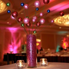 Just some ribbon in the container and christmas balls on sticks. An easy fun centerpiece.This would be great if you had a lot to do on a budget.