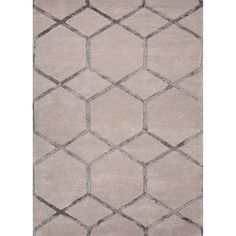 Over scaled sharp geometrics characterize this striking contemporary range of  Hand-tufted rugs. The high/low construction in wool and art silk creates texture and surface interest and gives a look of...