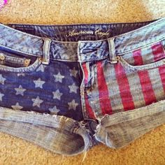 hand painted flag shorts (: super easy and pretty reasonable! for a fun and festive 4th of July outfit just grab a pair of jean shorts, painters tape, red and blue fabric paint, star stickers, and a brush!