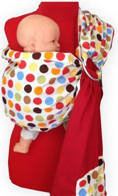 A wonderfully coloured and arranged Palm and Pond Baby Ring Sling, made from nothing but 100% cotton, featured in a red and polka dot design for a Mum...