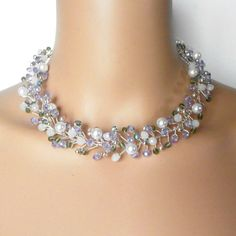 Youll feel like a princess in this gorgeously sparkling beaded wire necklace featuring tons of flashing, faceted beads. Ive included white glass