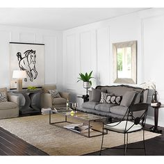 rug with furniture off of it...  living room?