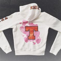 "NWOT VS PINK Texas Longhorns Full Zip Hoodie This unbelievably soft, super cute PINK Texas Hoodie would look amaze on a Horns Gal!  It is 100% new & unworn - I ordered it online a year or so back, so it didn't come with tags. I thought I'd wear it, bc I must have all things Texas, but I've not. Time for it to go to a new Hook 'Em home. Besides the Texas ""T"" and  graphic on the back, there's a ""Texas"" hit on the left sleeve and ""PINK"" on the hood - both in Texas Orange and black. Believe me…"