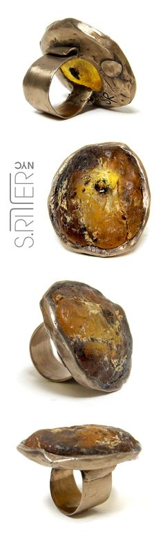 yellow glowing amber, with all of its area inclusion, delicately rounded out in bronze. it will warm you like the sun. || raw natural stone rings || elegant and raw statement rings || SRitterNYC.com