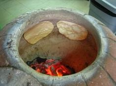 """Who would've thought some of the best bread in the world is baked in a gigantic clay pot? We would definitely have a tandoor oven out back for baking """"naan"""" (puffy, flat bread) and roasting chicken and lamb."""