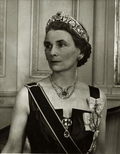 The late Duchess of Gloucester wearing the honeysuckle tiara &  pink beryl gems from Queen Mary.