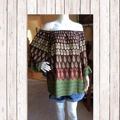 Boho top, love these colors! Boho top, love these colors! Loose flow on the arms with a small ruffle finish to the sleeve accent the fun of this boho style top. 100% Polyester Hand wash cold hand or line dry Made in the USA Tops