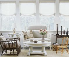 Choose Small-Scale Furnishings  Instead of filling your small space with hefty upholstered chairs and sofas and solid bureaus or side tables, choose slimmed-down, leggy pieces that allow you to see through them to the walls and floor. Rattan furniture, whether stained or painted, is visually lightweight and linear and works well in a cottage-style room. Even the child-size Windsor chair contributes to the open feeling, and the Empire-style coffee table, though bulky, blends in because of a…