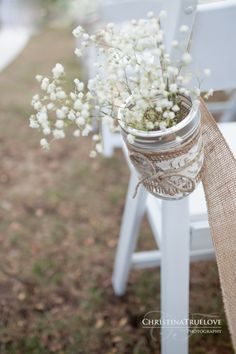 Fossil Creek Country Club wedding details baby's breath in mason jars with burlap and lace for aisle pew decor for an outdoor wedding