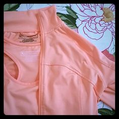 NWT Active Set Matching orange racerback tank with built in bra and track jacket with pockets on side and in sleeve. Jacket also has thumb holes! Never worn, perfect condition! [Listed as Nike for exposure] Nike Tops