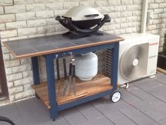 My bbq trolley, the bottom shelf is timber from the old fence