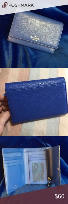 Kate Spade wallet NWOT Beautiful royal blue Kate Spade wallet with gold lettering and hardware has eight card slots ID slot inside Bill slot change purse beautiful wallet brand-new kate spade Bags Wallets