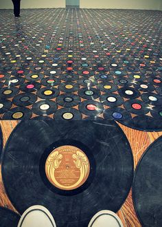 hmmm....dunno, but pinning it anyway. Vinyl records flooring, walls or ceiling!