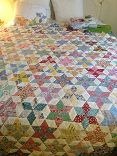 """My """"Stars"""" quilt is just about covering the bed. This one is hand stitched... English paper piecing diamonds."""