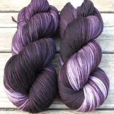 Mysterious eggplant purple with shifting creamy highlights and deep black shadows. While we call this a 'Repeatable Babette', every skein and every batch is a bit different. This colorway is also high