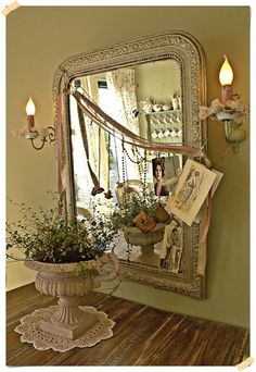 decorated mirror ~ nice vignette  old mantle mirror, would have been gold