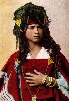 "Africa | ""Woman from Bou Saada"". Algeria. || Vintage postcard; publisher Jean Geiser. No. 196"