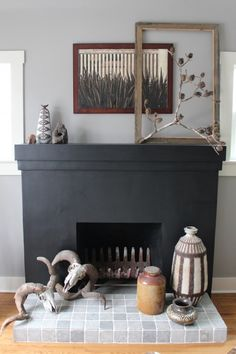 """Convincing Jesse to paint the fireplace black took over a week and Hanni created an inspiration board of black fireplaces to close the debate. We both love it!"""