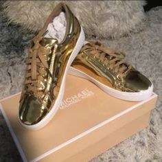 Michael kors metallic gold sneaker Worn once like new, not my pic but will upload later. Same shoes with box Michael Kors Shoes