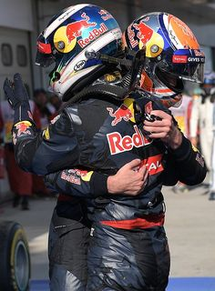 Red Bull Racing's BelgianDutch driver Max Verstappen congratulates his teammate Daniel Ricciardo after he won the Formula One Malaysian Grand Prix in...