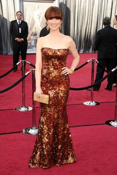 Ellie Kemper - in a strapless copper sequined Armani Prive gown, that perfectly matches her hair.