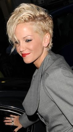 Short, left side and long, wavy swoop on the top and right