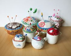 adorable pincushions from various vintage cups (by kitsch)