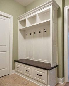 This handcrafted mudroom locker is painted with a stained solid maple seat. Built with solid maple and poplar hardwood and maple plywood, It features 3 solid maple wood drawers with Blum Blumotion soft-close undermount slides. All hooks and pulls are included. The finish is a
