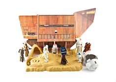 """The """"Land of the Jawas"""" Playset, featuring the sandcrawler, desert scene, and escape pod from the original """"Star Wars"""" movie. Figures sold separately; from Kenner"""