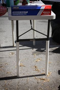 We posted about our adventures at the American Royal BBQ tournament yesterday over at The Kitchn, but while we were there one rather brilliant (new to us) idea really stood out.  Table leg extensions!   We quite often use a folding table of this nature for a portable workbench/holding area, but it can be a bit of a back strain...