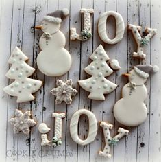 White & Gray Joy, Snowman, Tree and Snowflake Christmas Cookies, Accented with Blue Flower Buds Christmas Biscuits, Christmas Sugar Cookies, Christmas Sweets, Noel Christmas, Christmas Goodies, Holiday Cookies, Christmas Baking, White Christmas, Christmas Cakes