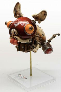 SCULPTURE : Michihiro Matsuo est un artiste japonais très inspiré par le courant steampunk, créant des sculptures à mi-chemin entre révolution industrielle et science-fiction. Ses créatures métalliques à la mécanique assemblée de toutes parts sont comme humanisées et semblent prendre vie