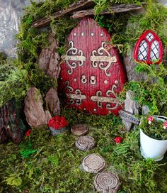 garden village tree stumps Large Red Fairy Door Set with windows to match and accessories for the Fairy Garden enthusiast. Size Tall x Wide. Fairy Tree Houses, Fairy Garden Houses, Gnome Garden, Fairy Door Kit, Fairy Garden Doors, Fairy Doors For Trees, Fairy Door Accessories, Minecraft Banner Designs, Miniature Fairy Gardens