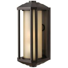 Off Castelle Bronze One Light Large Fluorescent Outdoor Wall Light by Hinkley. @ Castelle's transitional style features clean lines and a ribbed etched glass cylinder accented by etched amber corner panels, adding to its sophisticated look.