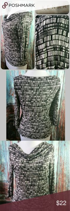 KENAR stretch top Fitted stretchy top with 3/4 length sleeves and draped neck. Black and white pattern. Good condition Kenar Tops