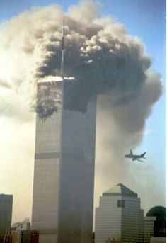 Terrorist attack on World Trade Center. The second hijacked plane is seen as it is about to hit the second tower of the World Trade Center on Tuesday, September --- Photo by Dan Joyce/Corbis SABA 11 September 2001, Remembering September 11th, World Trade Center Attack, Trade Centre, We Will Never Forget, Lest We Forget, 911 Twin Towers, Wtc 9 11, Nine Eleven