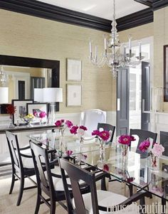 A simple yet elegant dining room. Design: Ken Fulk. Photo: Francesco Lagnese. housebeautiful.com #grasscloth_walls #glass_tables #crown_molding #chandelier