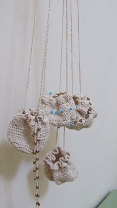 Crocheted amulet bags made with yarn thread and beads.