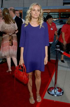 Diane Kruger in Chloé dress and red Balenciaga bag - Premiere of 'Sicko' in Los Angeles.