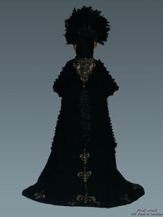 TPM.  Back view of black 'Invasion' costume.