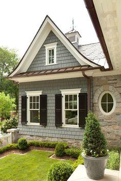 Round window inspiration - exterior stone house