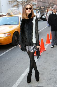 Black and White Leather Sleeved Jacket, Fur Scarf, Printed Skirt, Tights, and Booties
