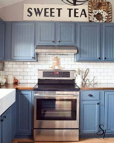 I Spy our Embossed Sweet Tea sign above these gorgeous blue #kitchen cabinets! Thanks for sharing!  #homedecor