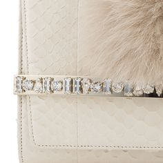 CLose up details of the Jimmy Choo BOW clutch