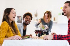 Group of friends having lunch at home. by BONNINSTUDIO for Stocksy United Lunch Photos, Group Of Friends, People Eating, The Unit, Stock Photos, Juice, Photography, Dashboards, Photography Business